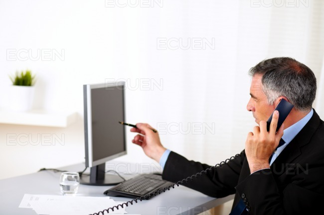 Elegant businessman pointing the computer stock photo