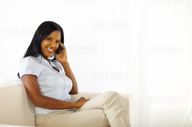 Elegant young woman on mobile phone stock photo