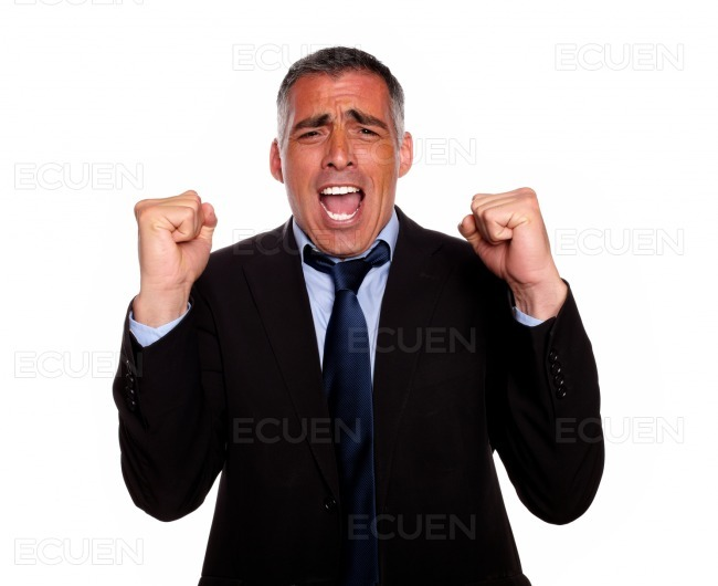 Excited and happy broker celebrating a victory stock photo