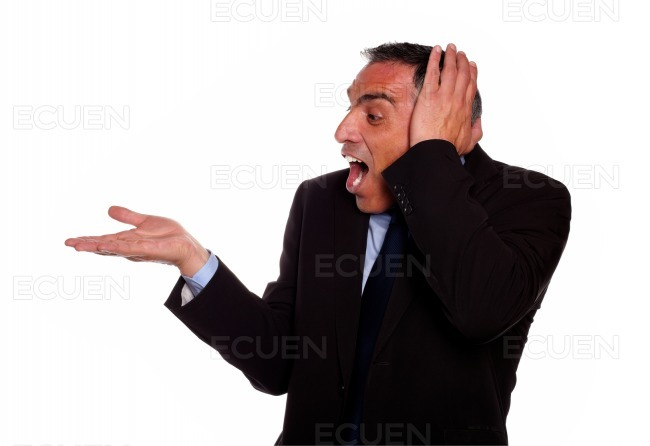 Excited businessman screaming with extended hand stock photo