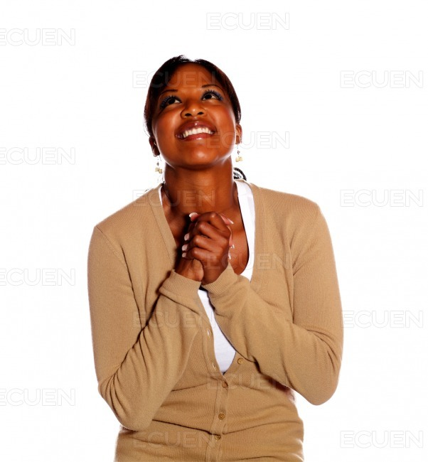 Excited happy black woman looking up