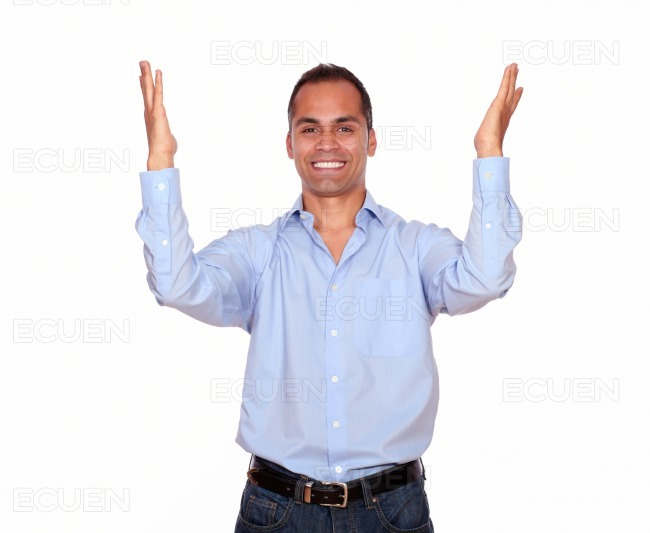 Excited latin man celebrating a victory