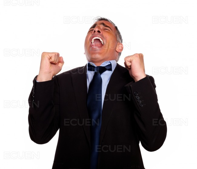 Excited man celebrating a victory stock photo