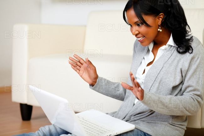 Excited stylish woman looking to laptop screen stock photo