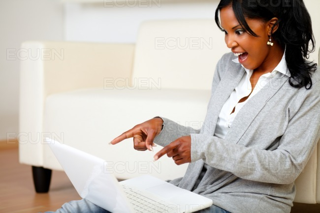 Excited stylish woman pointing the laptop screen stock photo
