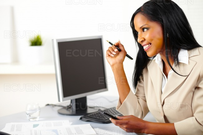 Executive female using a cellphone stock photo