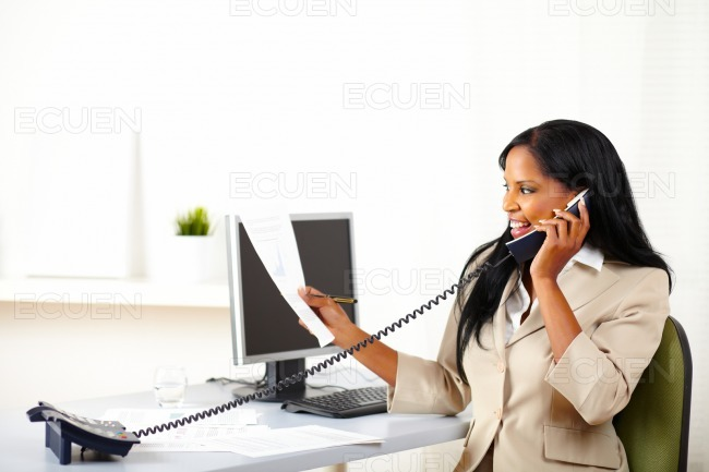 Executive on phone and looking to documents stock photo