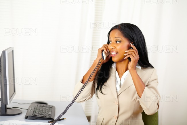 Executive woman speaking with two persons stock photo