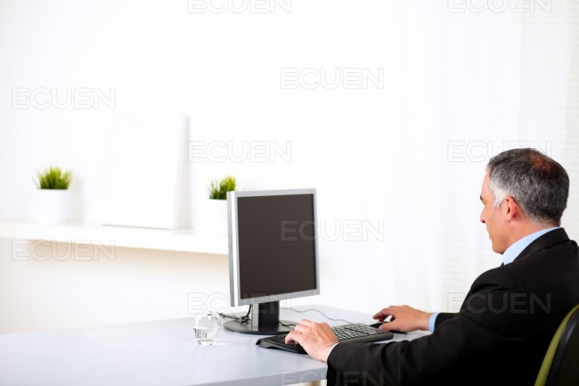 Executive working on computer stock photo