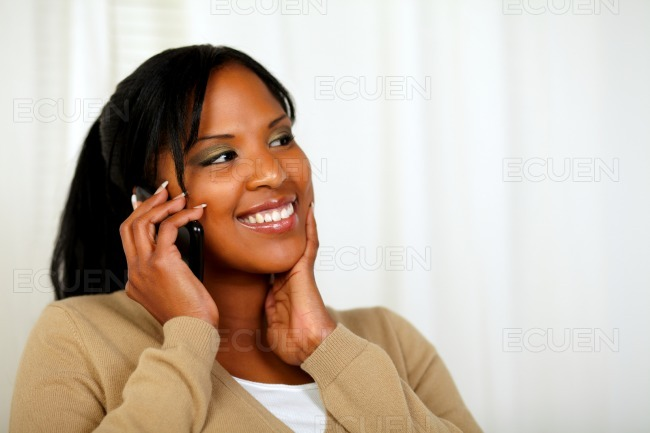 Fresh woman smiling and conversing on mobile stock photo