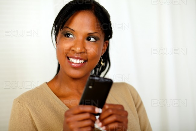 Friendly black woman sending a message stock photo