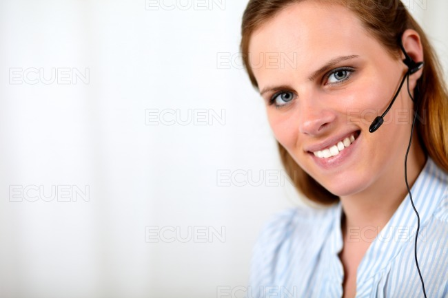 Friendly blonde secretary smiling and talking stock photo