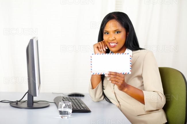 Friendly business lady showing a letter stock photo