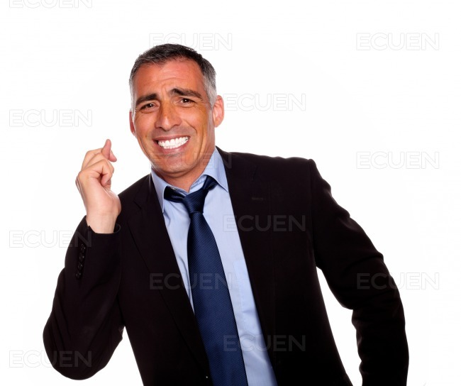 Friendly businessman crossing fingers stock photo
