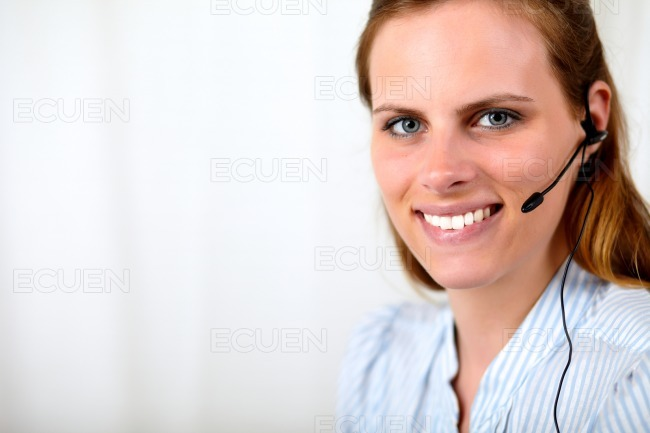 Friendly caucasian operator smiling and speaking stock photo
