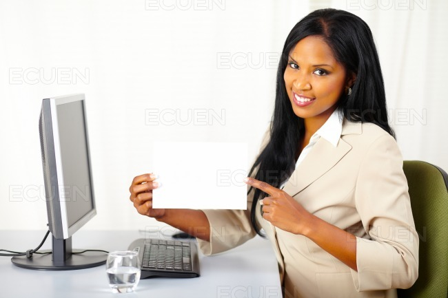Friendly executive lady showing a white card stock photo