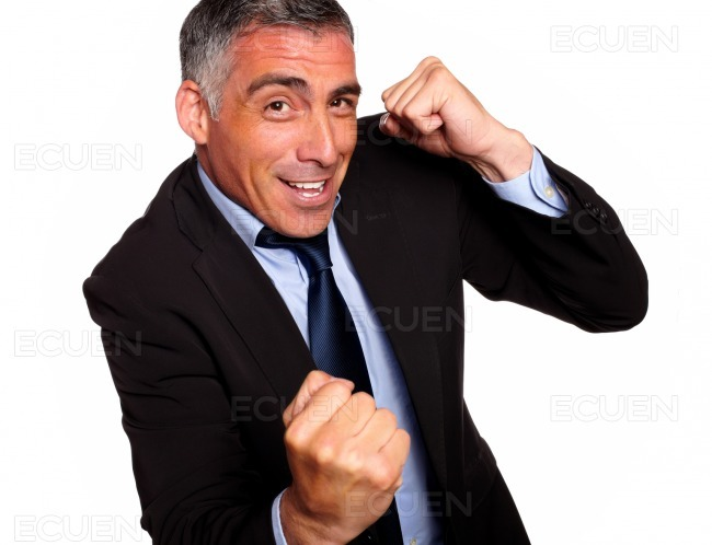 Friendly hispanic businessman boxing stock photo