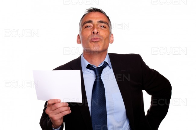 Friendly senior businessman showing a while card stock photo