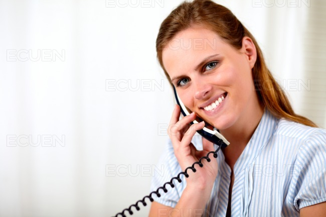 Friendly young woman smiling and speaking stock photo