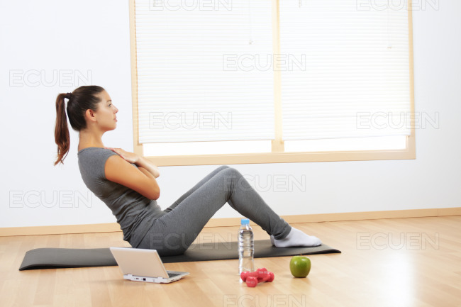 Girl doing sport exercises stock photo