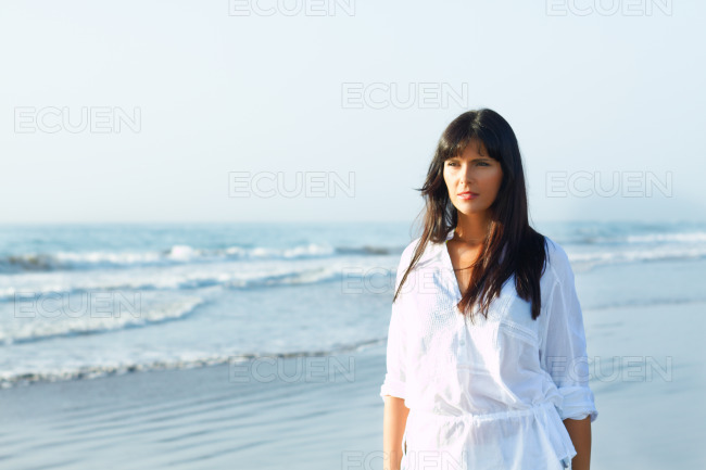Girl walking along the seashore stock photo
