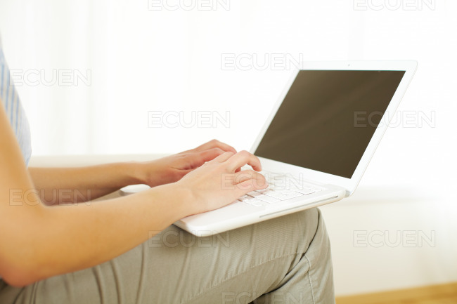 Girl working with a laptop stock photo