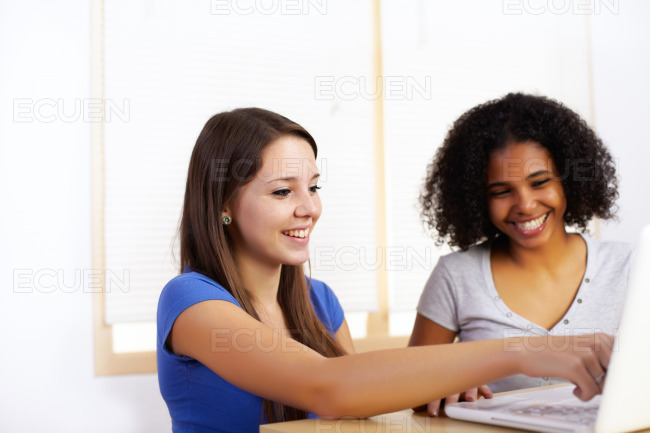 Girls using a laptop stock photo