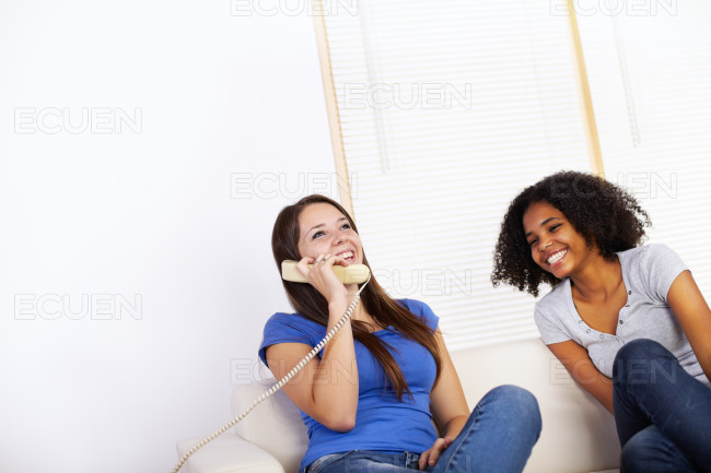 Girls using a phone stock photo