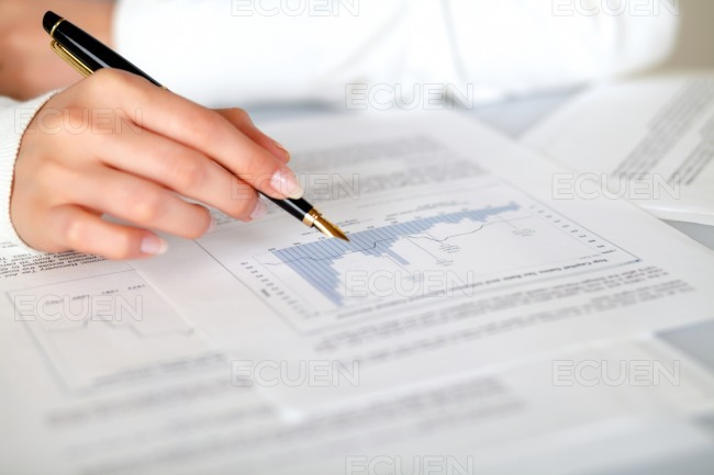 Hand of a woman pointing a graph stock photo