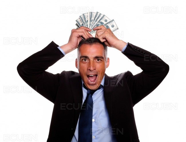 Happy and excited man celebrating a victory stock photo
