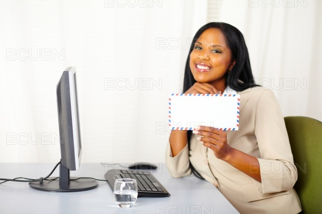 Happy professional businesswoman showing a letter stock photo