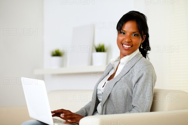 Happy woman browse the Internet on laptop stock photo