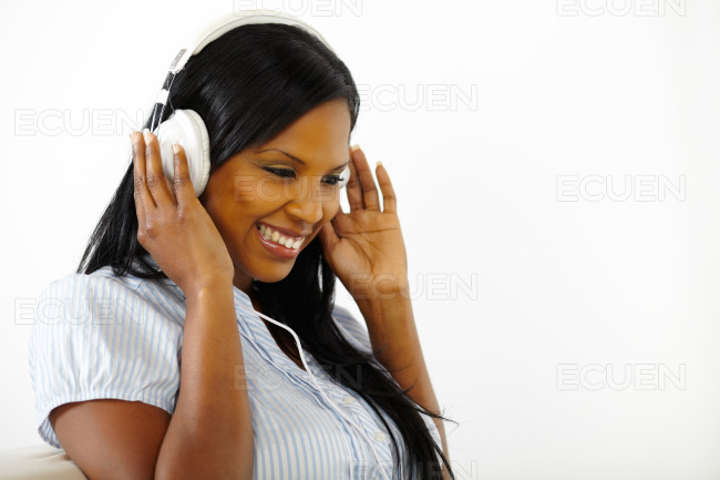 Happy young female listening to music stock photo