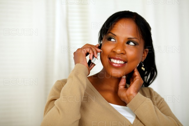 Independent young woman speaking on cellphone stock photo
