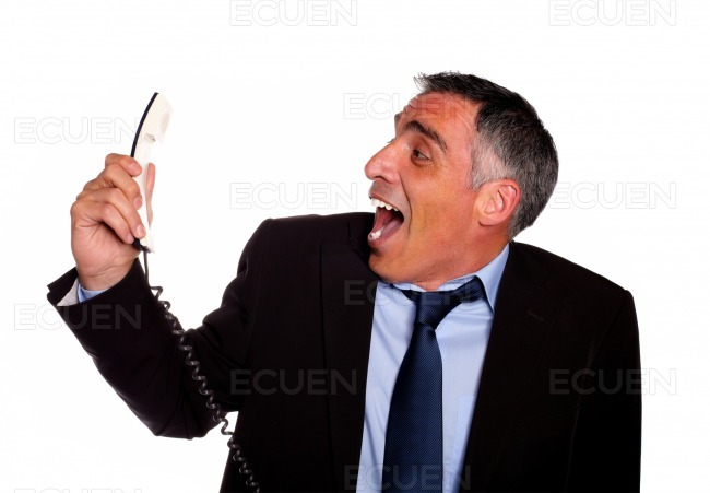 Latin business man laughing with a phone stock photo