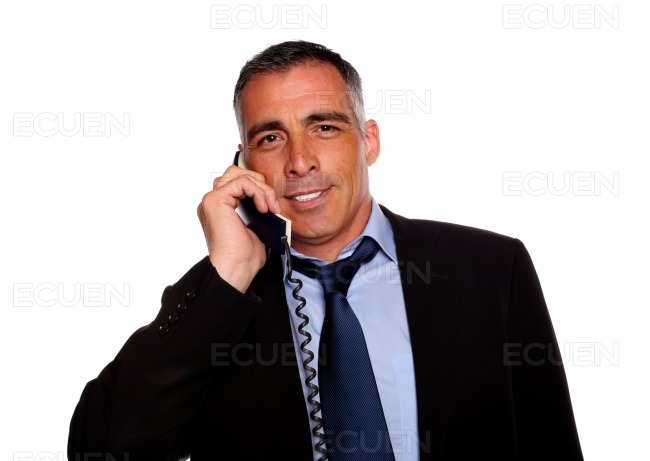 Latin charismatic businessman smiling with a phone stock photo