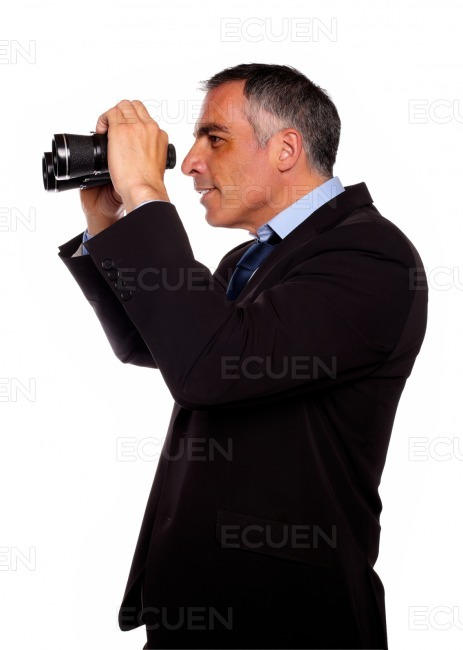 Latin senior businessman looking forward stock photo