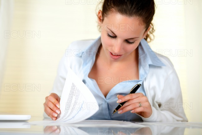 Lovely businesswoman working with documents