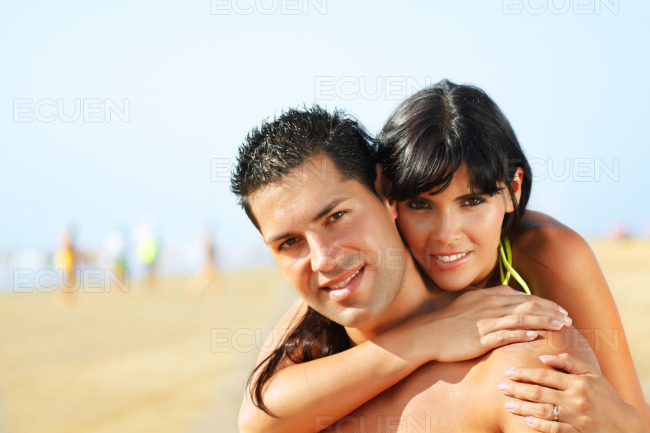 Lovely couple on the beach stock photo