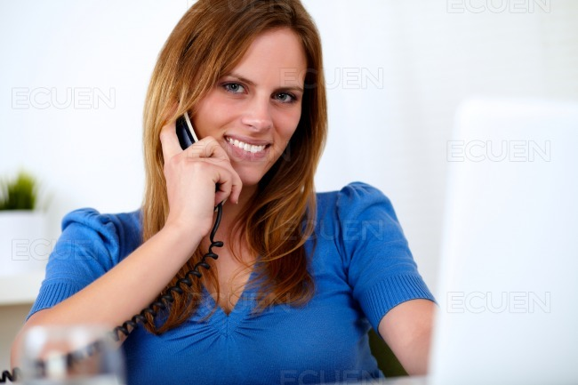 Lovely pretty woman smiling and speaking on phone stock photo