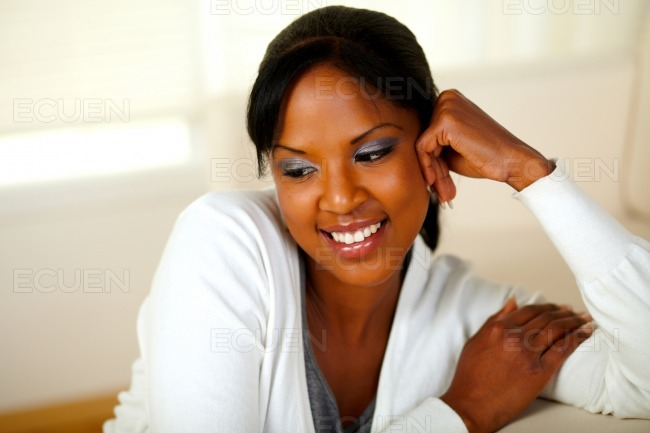 Lovely relaxed girl smiling and looking down stock photo