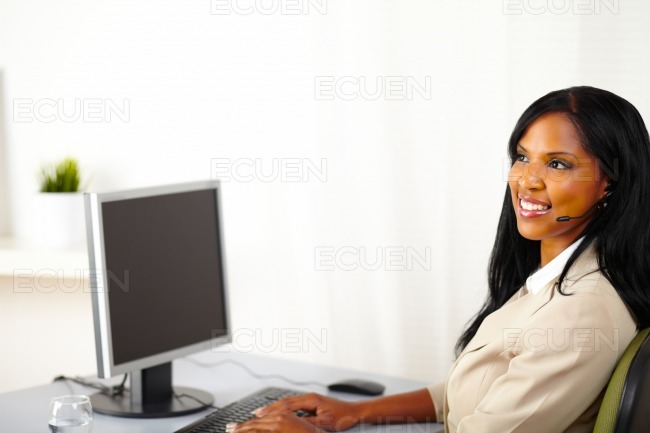 Lovely secretary working on computer stock photo