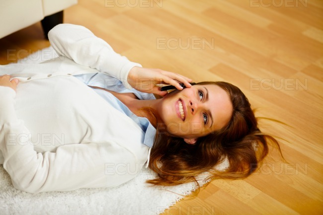 Lovely woman making a call on the cell phone stock photo