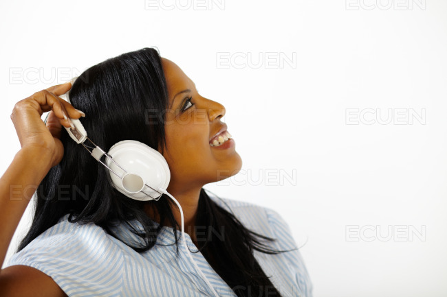 Lovely young female listening to music stock photo