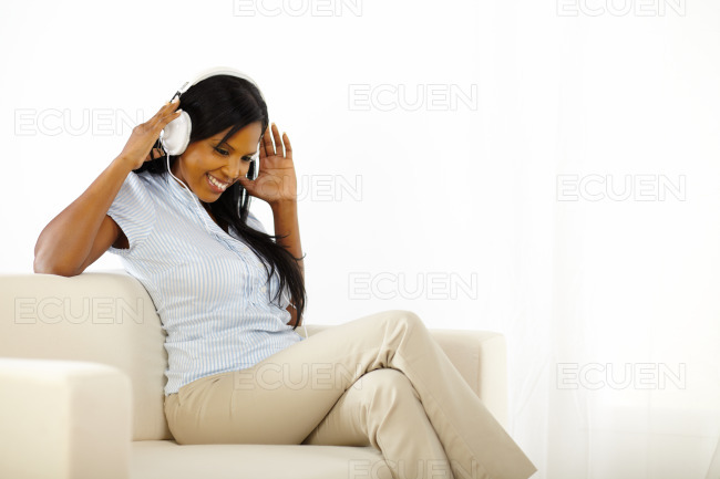 Lovely young lady listening to music stock photo