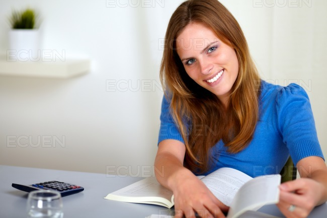 Lovely young student woman smiling stock photo