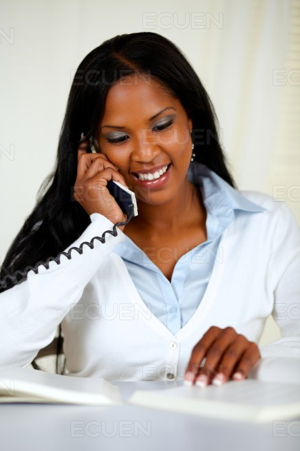 Lovely young woman on phone stock photo