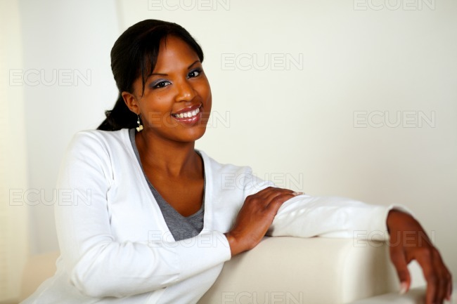 Lovely young woman smiling and looking at you stock photo