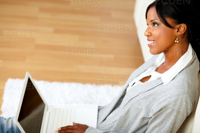 Lovely young woman smiling and looking up stock photo