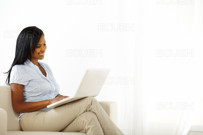 Lovely young woman working on laptop stock photo